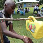 The Water Project: Ematiha Community, Ayubu Spring -  A Boy Uses The Handwashing Station