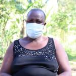 The Water Project: Mukhangu Community, Okumu Spring -  Felistus Masked Up