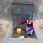 The Water Project: Kapkemich Primary School -  Beatrice Collecting Water