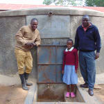 The Water Project: Kapkemich Primary School -  Beatrice With Field Officer Sam And Teacher Wycliffe Khamali