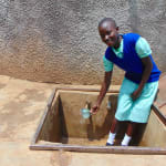 The Water Project: Ingwe Primary School -  Jackline Fetching Water To Drink