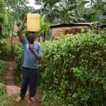 The Water Project: Hirumbi Community, Khalembi Spring -  Gillian Carrying Clean Water Home