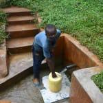 The Water Project: Hirumbi Community, Khalembi Spring -  Gillian Fetching Water