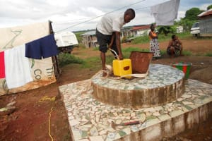 The Water Project: Allen Town Kiosk Well Rehabilitation Project -