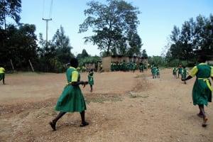 The Water Project: Mahanga Primary School -  Girls Rushing To Latrines