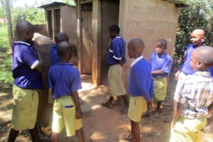 The Water Project: Emmabwi Primary School -  Boys Waiting For Latrines