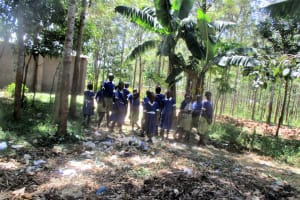 The Water Project: Emmabwi Primary School -  Pupils Throwing Garbage On School Farm