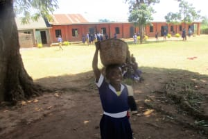 The Water Project: Emmabwi Primary School -  Pheobe Aunga Bring Maize Flour To School For Lunch