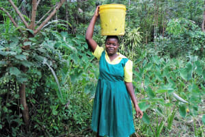 The Water Project: Mahanga Primary School -  Fetching Water