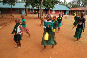 The Water Project: Emurembe Primary School -  Flavian Carrying Her Jerrycan