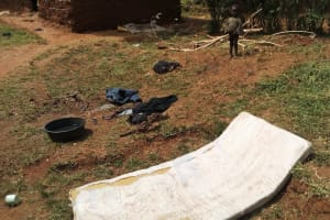 The Water Project: Shitungu Community, Hessein Spring -  Clothes Drying On Ground