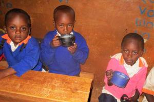 The Water Project: Essunza Primary School -  Ecd Eating Porridge