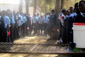 The Water Project: Ikonyero Secondary School -  Students Lined Up For Tea