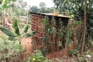 The Water Project: Shitungu Community, Hessein Spring -  Side Of Traditional Latrine