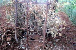 The Water Project: Kidinye Community, Wamwaka Spring -  Latrine