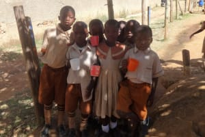 The Water Project: Compassion Primary School -  Students With Water Cups