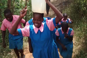 The Water Project: Virembe Primary School -  Carrying Water Back
