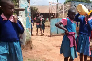 The Water Project: Virembe Primary School -  Pupil Drinking From Jerrycan