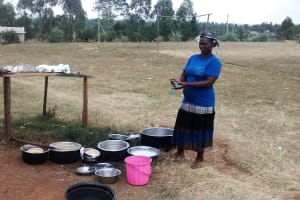 The Water Project: Virembe Primary School -  Cook Washing Utensils