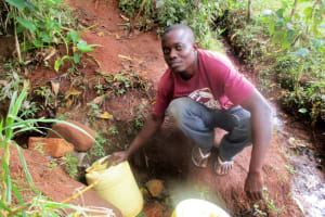 The Water Project: Emabungo Community, Bondeni Spring -  Fetching Water