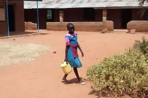 The Water Project: Virembe Primary School -  Carrying Water