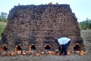 The Water Project: Mwinaya Community, Severe Spring -  Baking Bricks