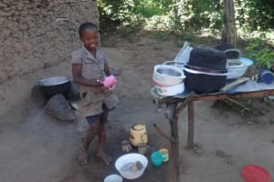 The Water Project: Shitungu Community, Suleiman Spring -  Shanila Poses Before Her Improvised Dish Rack