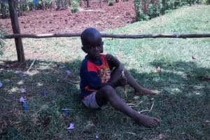 The Water Project:  Elvis Eating A Wet Maize Stalk Since His Parents Cannot Afford Lunch