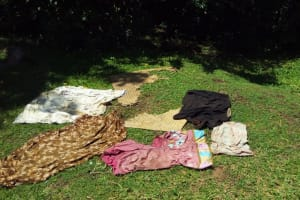 The Water Project: Emarembwa Community, Nyangweso Spring -  Clothes Drying On Ground