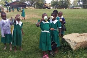 The Water Project: Kalenda Primary School -  Eating Porridge
