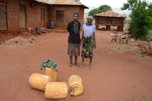 The Water Project: Katitu Community -  Women With Water Containers