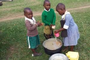 The Water Project: Kalenda Primary School -  Washing Porridge Cups