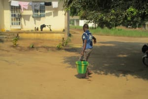 The Water Project: Tintafor, Officer's Quarters Community -  Carrying Water