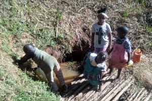 The Water Project: Bumavi Community, Shoso Mwoga Spring -  Fetching Water
