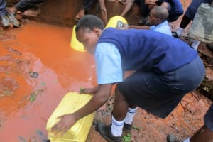 The Water Project: Digula Secondary School -  Cleaning Container At Spring