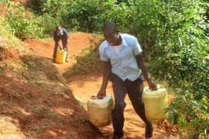 The Water Project: Digula Secondary School -  Elvis Carries Heavy Water Containers