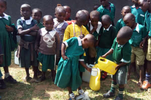 The Water Project: Kalenda Primary School -  Pouring Drinking Water