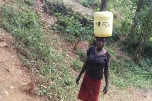 The Water Project: Shitaho Community, Andrea Kong'o Spring -  Balancing On Head