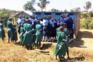 The Water Project: St. Marygoret Girls Secondary School -  Girls Waiting In Front Of Their Latrines
