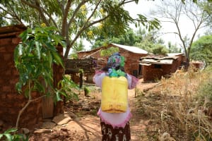 The Water Project: Mbuuni Community -  Carrying Water