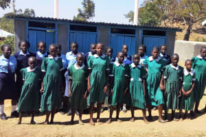 The Water Project: St. Marygoret Girls Secondary School -  Girls Pose In Front Of Their Only Latrines