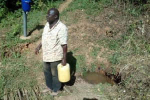The Water Project: Bumavi Community, Shoso Mwoga Spring -  Mr Ambasi
