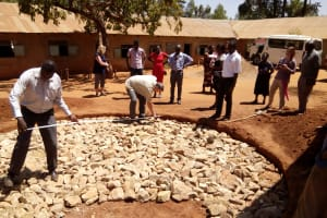 The Water Project: Shipala Primary School -  Measuring The Diameter