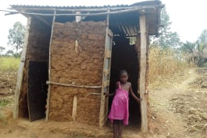 The Water Project: Eshiakhulo Community, Omar Sakwa Spring -  Little Girl Shows Her Latrine