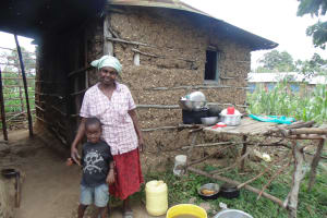 The Water Project: Murumba Community, Muyokani Spring -  Mother And Son Next To Dish Rack
