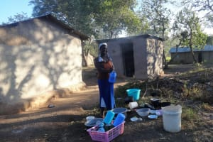 The Water Project: Lutari Community -  Woman Washing Dishes