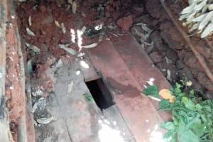The Water Project: Wanzuma Community, Wanzuma Spring -  Latrine Floor
