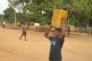 The Water Project: Victory Evangelical Church -  Carrying Water