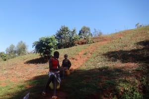 The Water Project: Lutari Community -  Community Members Wait At The Spring