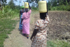 The Water Project: Eshiakhulo Community, Omar Sakwa Spring -  Carrying Water From Spring